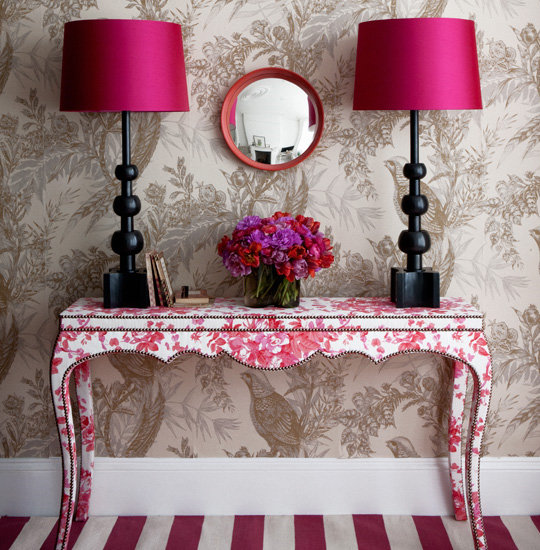 Toile on toile in contrasting colors and scales adds an incredible layer of dimension without overwhelming the space. Ruby and taupe might just be my new favorite neutral and bright color combination.  Source