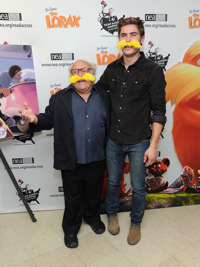 Zac Efron and Danny DeVito Get Into Character For a Kid-Friendly Appearance