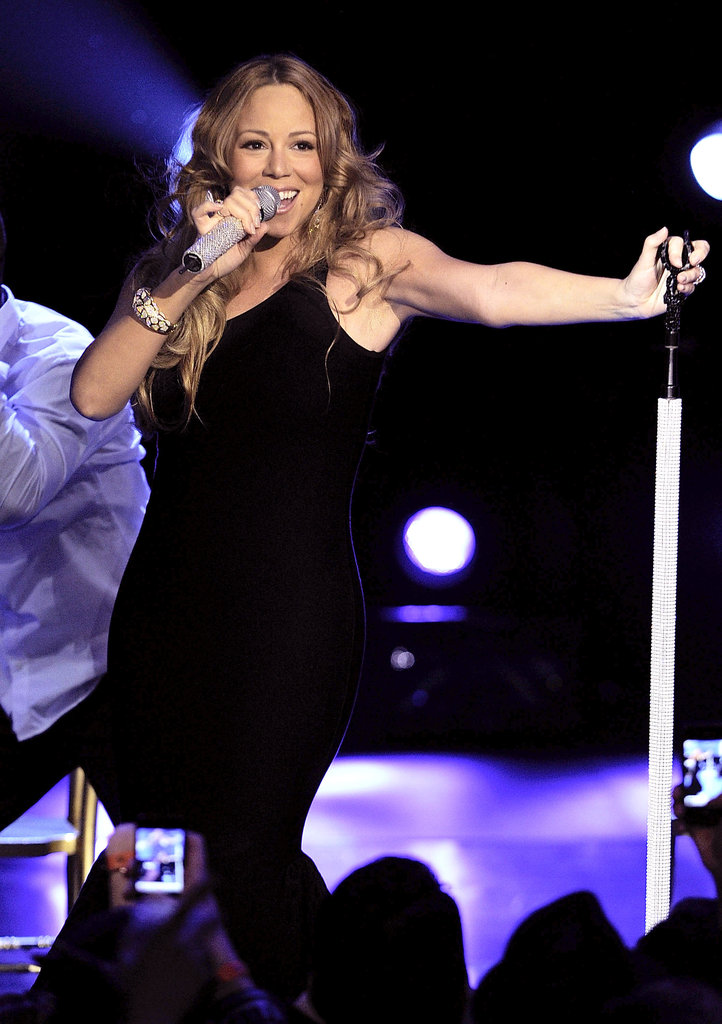 Mariah Carey performed in NYC in a black dress.