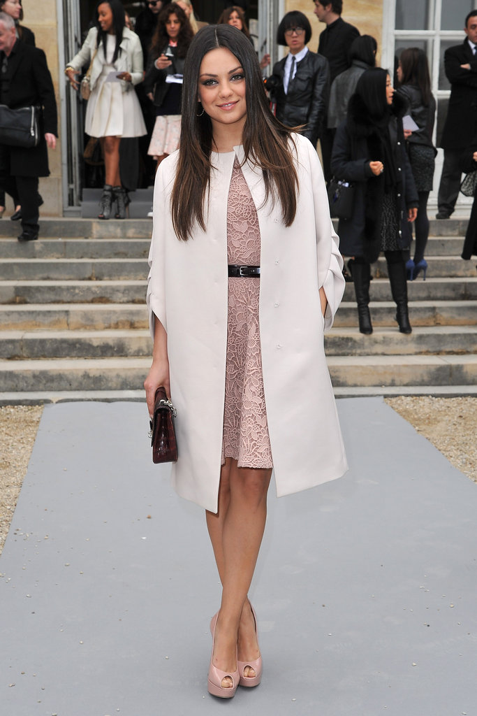 Mila Kunis decked out in feminine Dior at the brand's fashion show.