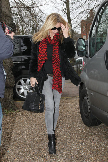 Kate Moss worked a bold-printed scarf to liven up her gray denim.