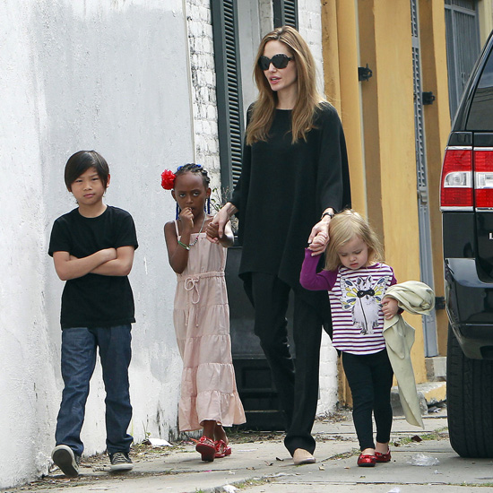 Angelina Jolie was in mommy mode as she ventured out with half of her brood in New Orleans on Sunday (March 11).