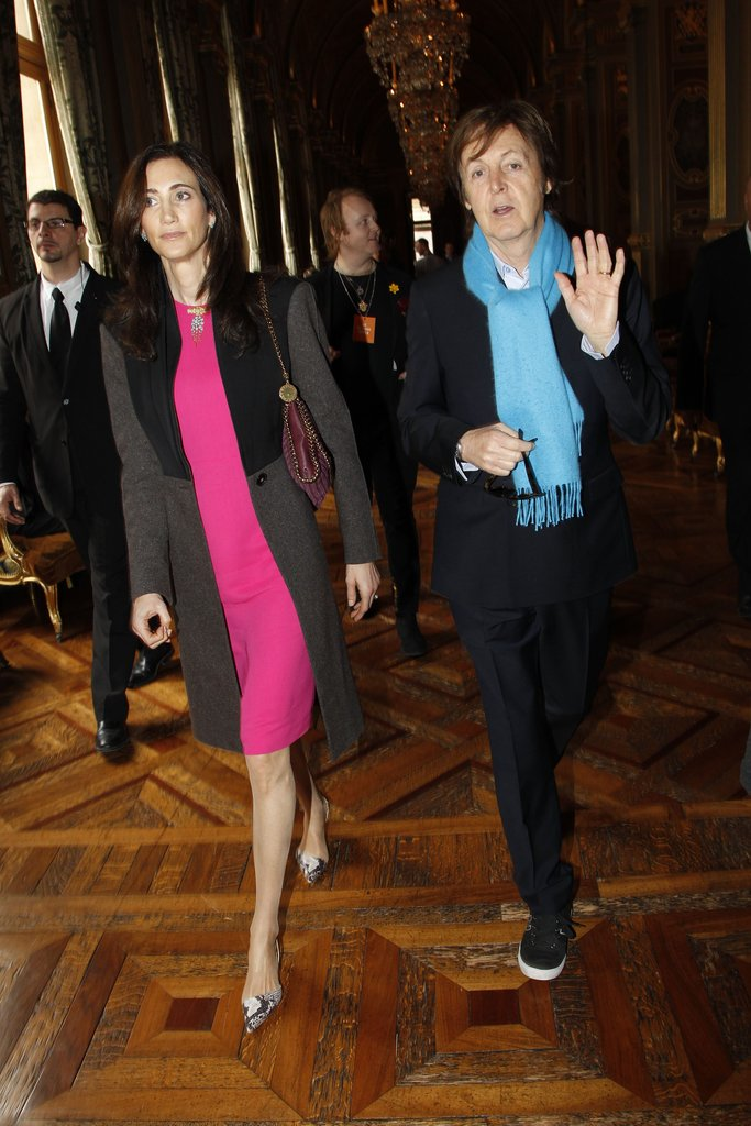 Paul McCartney and Nancy Shevell posed at the Stella McCartney Fall 2012 show.
