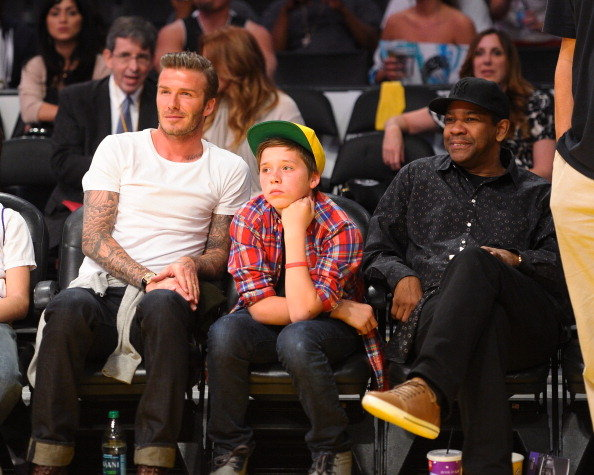David Beckham with Brooklyn and Denzel Washington at a basketball game.