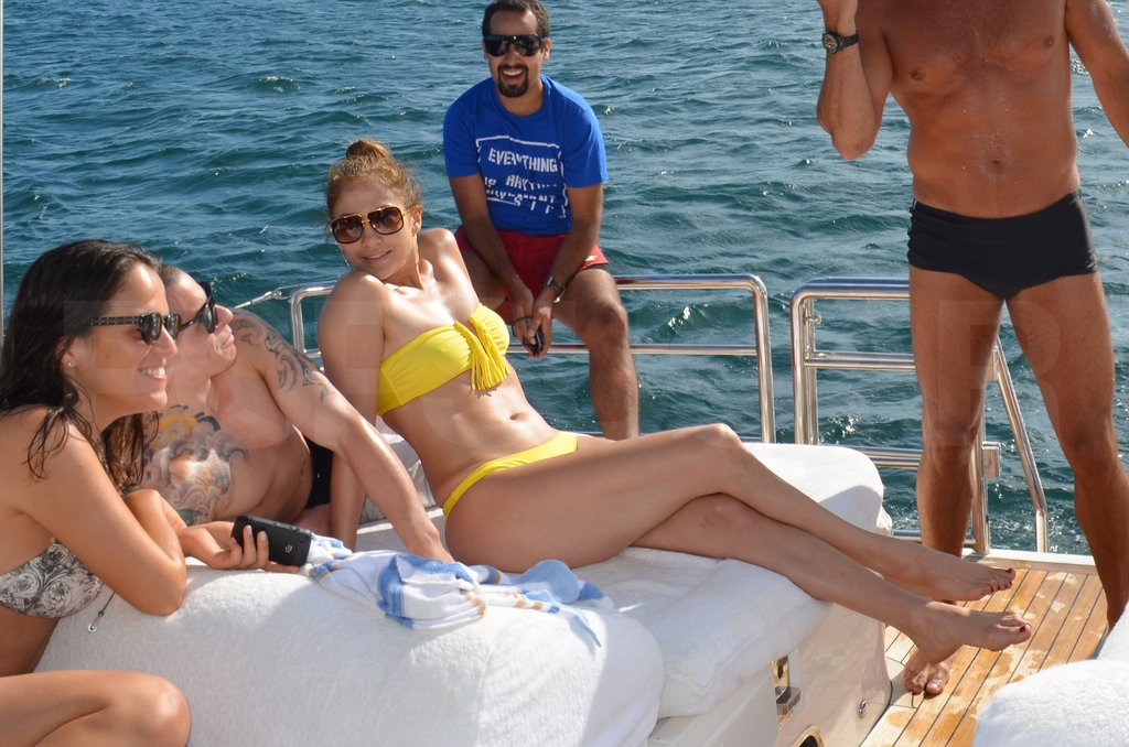 Jennifer Lopez wore a yellow bikini.