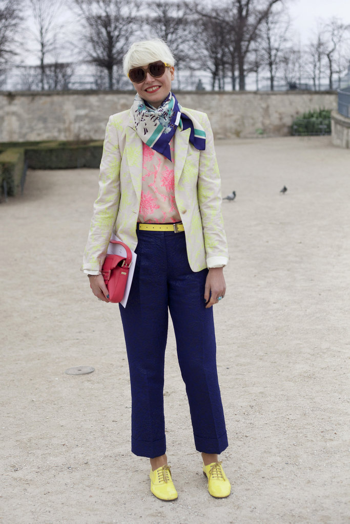 Elisa Nalin showed off her love for colors in coral floral-printed blouse, citron blazer, navy pants, and bright yellow accessories. We love her fresh take on styling brights.