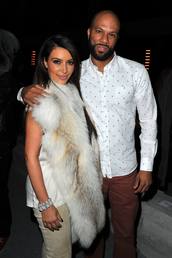 Kim Kardashian posed with Common at Kanye West's show.