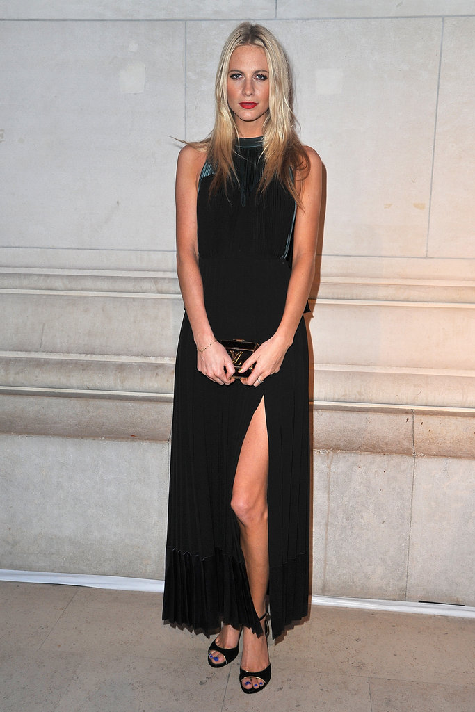 With a sexy thigh-high slit in tow, Poppy Delevigne stunned in this black dress.