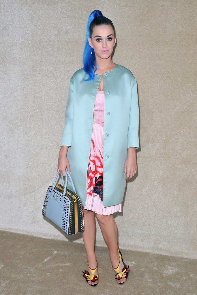 http://www.fabsugar.com/node/21986961/edit/photosKaty Perry made her way into Miu Miu — with hair to match her bag and coat.