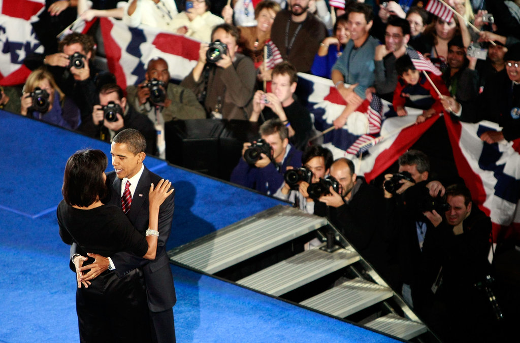 Michelle and Barack embrace after his victory speech.