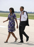 Barack keeps Michelle close as they land in Illinois in August.