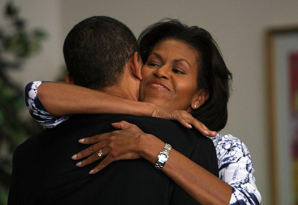 Michelle gave Barack a big hug in Oregon.