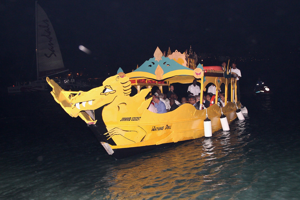Prince Harry took a boat in Jamaica.