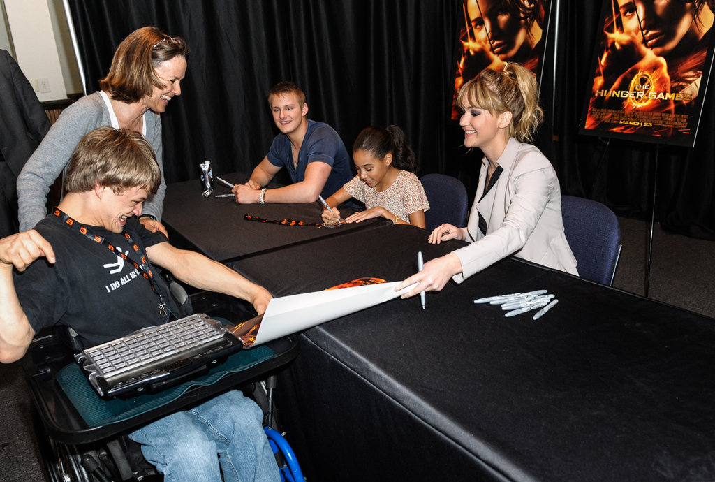 Fans waited in line to get their Hunger Games posters signed by the cast.
