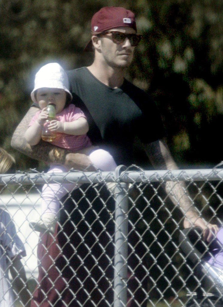 David Beckham holds daughter Harper Beckham.