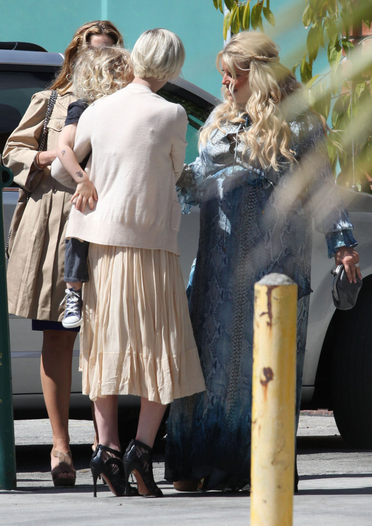 Ashlee Simpson arrives at her sister Jessica's baby shower with son Bronx.