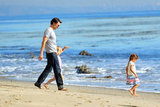 Olivier Martinez spent a sweet day at the beach with Nahla Aubry in January 2012.