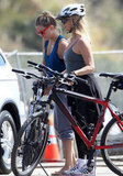 Kate Hudson and Goldie Hawn riding bikes.