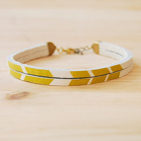 This dainty handmade bracelet is high on our Spring shopping list.  Son of a Sailor Handpainted Leather Bracelet ($28)