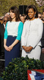Samantha Cameron and Michelle Obama look chic at the ceremony.