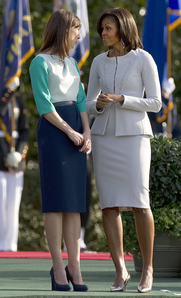 Michelle Obama and Samantha Cameron chat on the White House lawn.