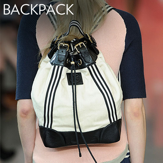Why we love them: The backpack is a no-brainer when it comes to functionality — but these aren't the ones you remember from middle school. These iterations are textured, streamlined, and made over in awesome color to feel infinitely cooler. How to wear it: These will pair best with your casual looks. Try a woven style for a beachy vacation with a maxi skirt and a breezy tee; add Alexander Wang's sportier version to bold-hued trousers for a chic finish. Photo: Tory Burch Spring 2012