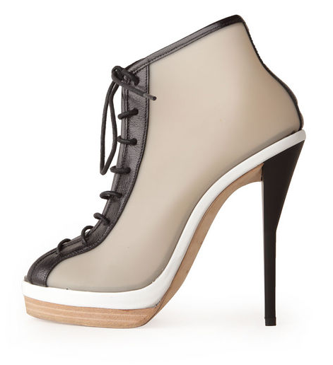 "The two-tone sole had us at ""hello,"" but we also can't help but love how athletic and girlie this bootie manages to be. A Spring '12 trend win-win. 3.1 Phillip Lim Akita lace-up bootie ($850)"