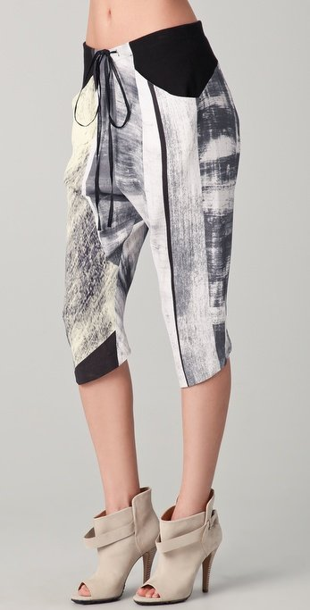 We love the supercropped hemline and sporty drawstring twist on these abstract printed trousers.  Helmut Lang Parallel Print Drawstring Pants ($360)