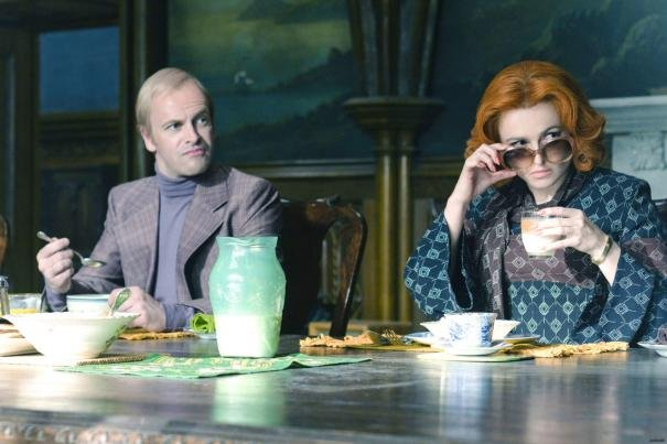 Jonny Lee Miller as Roger Collins and Helena Bonham Carter as Dr. Julia Hoffman in Dark Shadows.  Photo courtesy of Warner Bros.