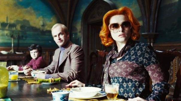 Gulliver McGrath as David Collins, Jonny Lee Miller as Roger Collins, and Helena Bonham Carter as Dr. Julia Hoffman in Dark Shadows.  Photo courtesy of Warner Bros.