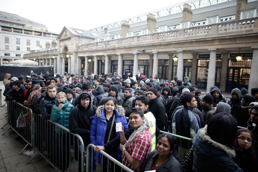 Apple fans wait in Covent Garden, London.