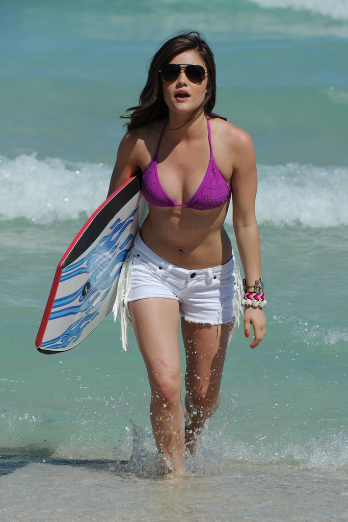 Lucy Hale wore a purple bikini top and white cutoff shorts while visiting the Bongo Beach Shack in Miami in March 2012.