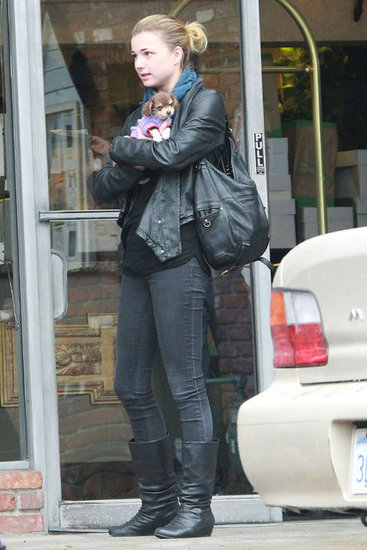 Emily VanCamp wearing a leather jacket.