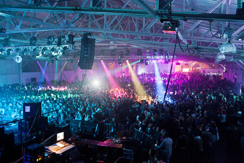 A view of the crowds inside one of the pavilions during a music performance.