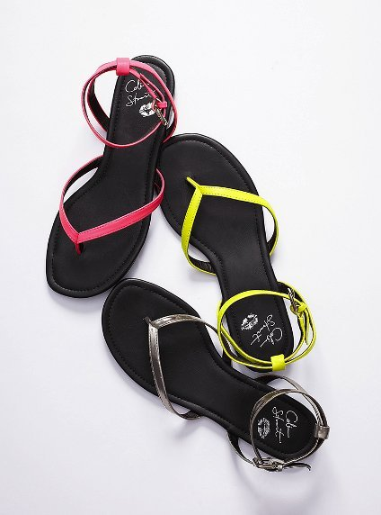 A step up from a flip-flop, wear these color-popping thong sandals with ankle straps so you can walk to the pool in style.  Colin Stuart Ankle-Wrap Flat Sandal ($39)