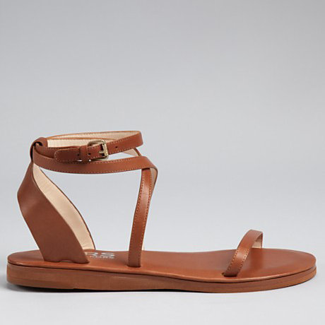 This golden tan leather sandal is perfect for any daytime adventure, and the crisscrossed ankle wrap adds just enough interesting detail. KORS Michael Kors Sandals in Rosemary Flat ($135)