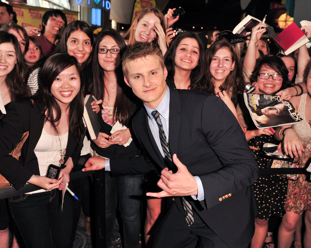 Alexander Ludwig cozied up to his fans at the Hunger Games premiere in Canada.