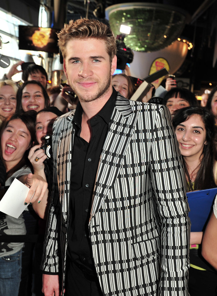 Liam Hemsworth posed with his fans at the Hunger Games premiere in Canada.