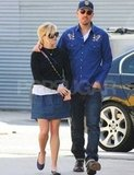 Jim Toth put his arm around Reese Witherspoon while walking in LA in March 2011.