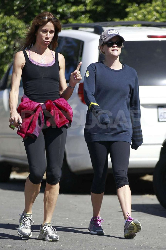 Reese Witherspoon steps out with a friend in LA amidst pregnancy rumors.