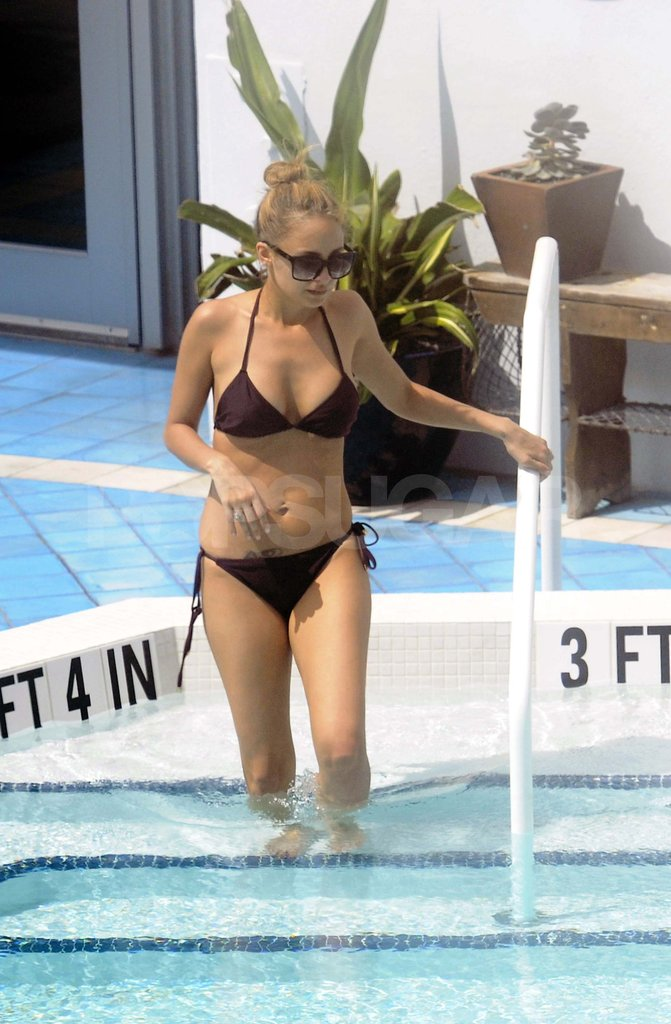 Nicole Richie goes for a swim in the pool of her Miami Beach hotel.