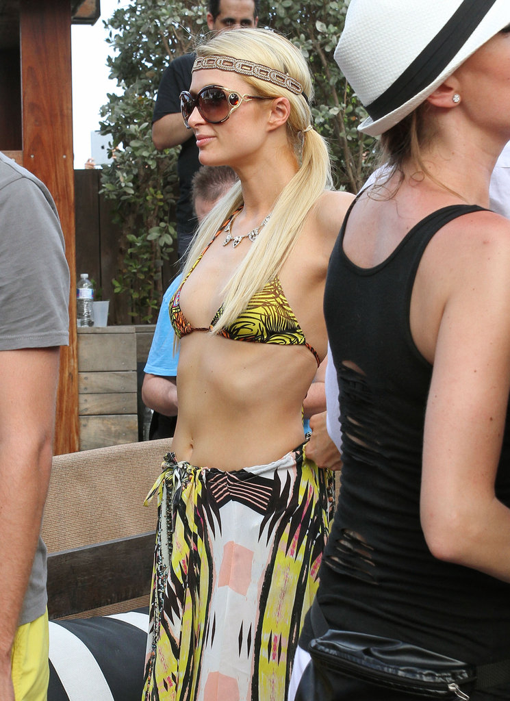 Paris Hilton showed off her figure poolside in Miami.