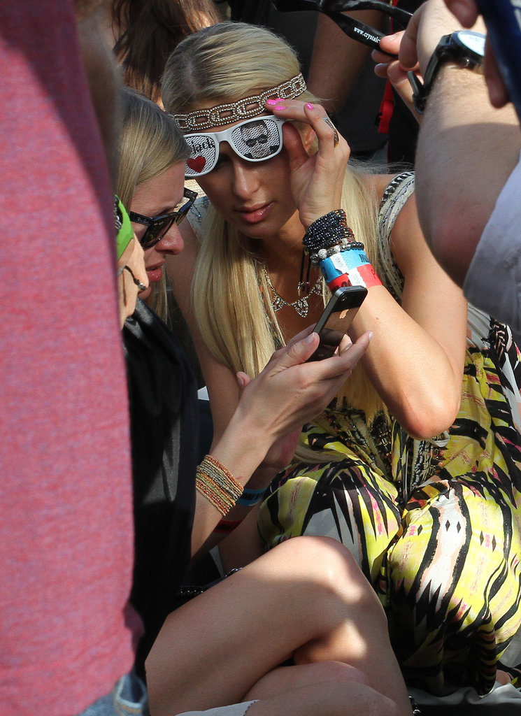 Paris Hilton and Nicky Hilton checked their phone while hanging out in  Miami.