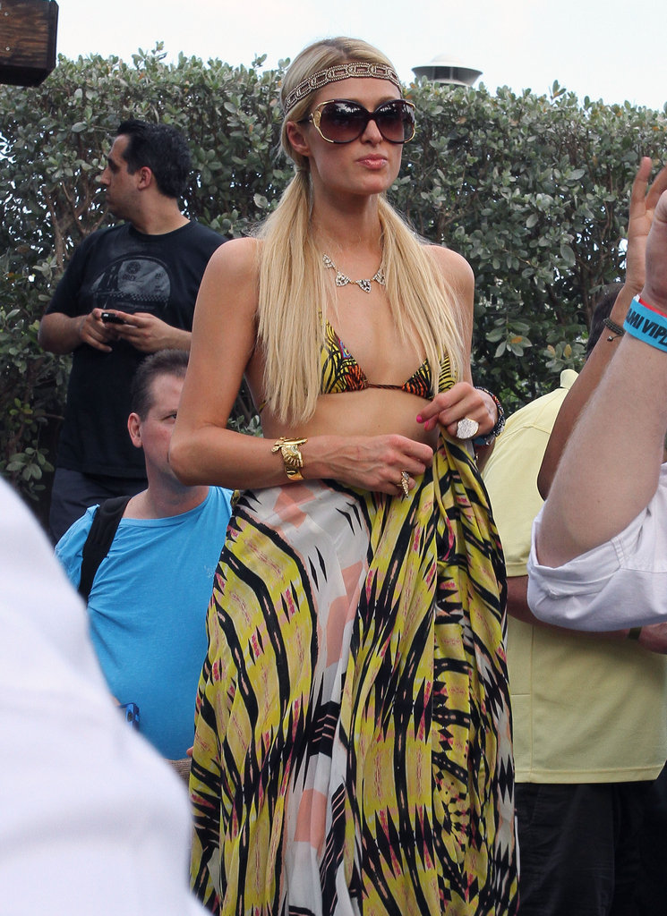 Paris Hilton was in Miami wearing a bikini with pigtails, over-sized sunglasses and a headband.