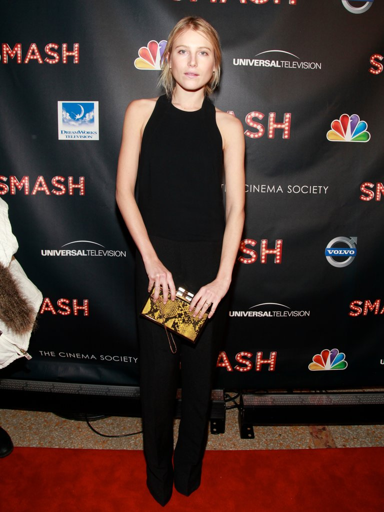 Dree Hemingway played up a black jumpsuit with a boxy snake-print clutch in hand.