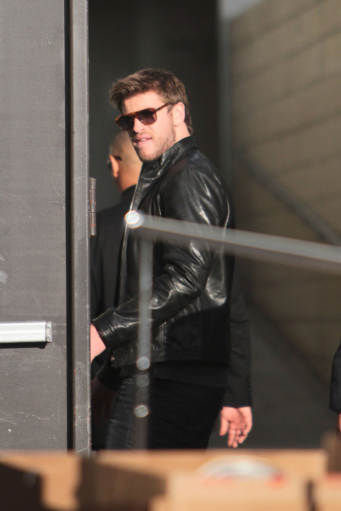 Liam Hemsworth sported shades as he arrived.
