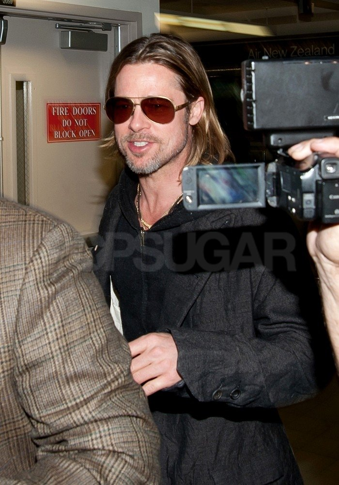 Brad Pitt Touches Down While Angelina Talks About Her Sexy Oscar Dress