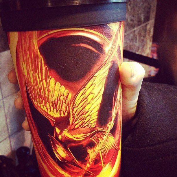 The PopSugar team couldn't resist showing off their awesome Hunger Games cups from the theater. Follow them at popsugar!