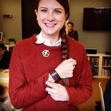 """PopSugar editor and Instragram user mollygoodson had a complete look for Hunger Games Friday: braid, Hunger Games slap bracelet, Mockingjay pin, and red sweater, for that """"girl on fire"""" feeling."""