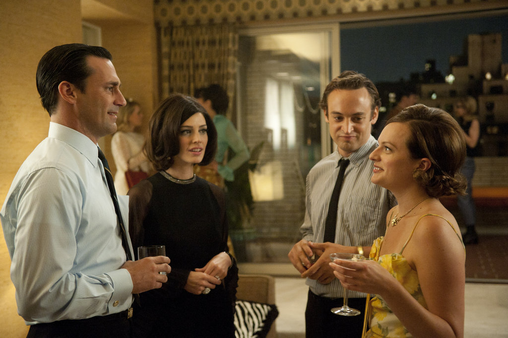 Jon Hamm as Don Draper, Jessica Paré as Megan Draper, Charlie Hofheimer as Abe, and Elisabeth Moss as Peggy Olson on Mad Men.  Photo courtesy of AMC